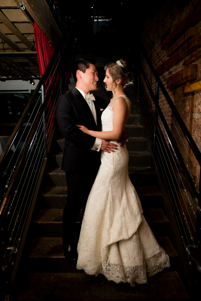 Bride and groom in Vinology's basement