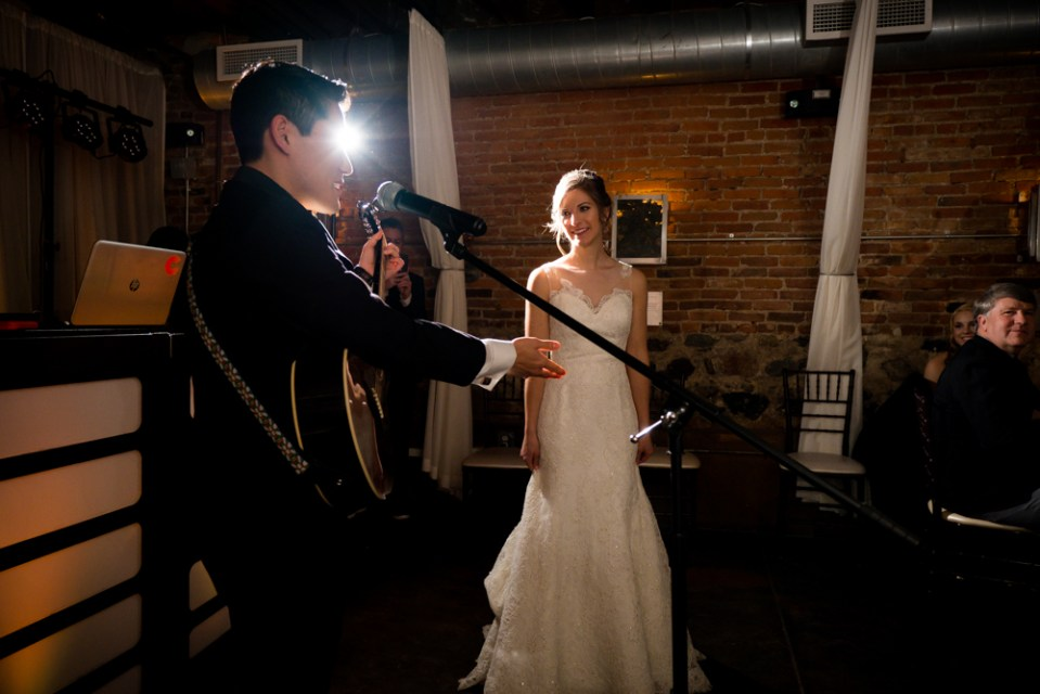 Groom serenading his bride