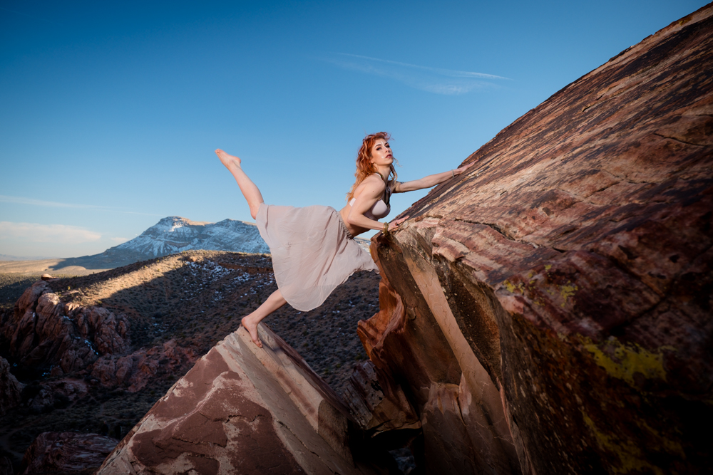 Dancer dancing on the edge of a cliff
