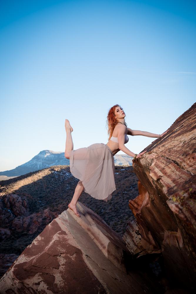 Striking pose on a cliff edge