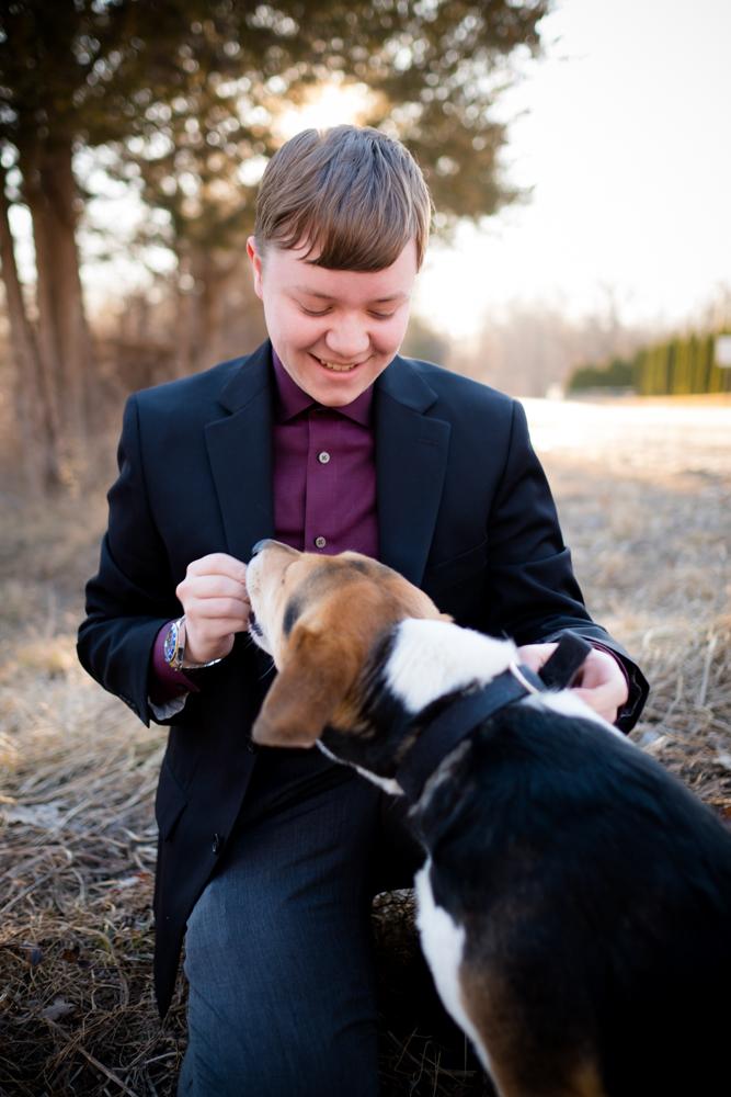 high school senior boy with his dog
