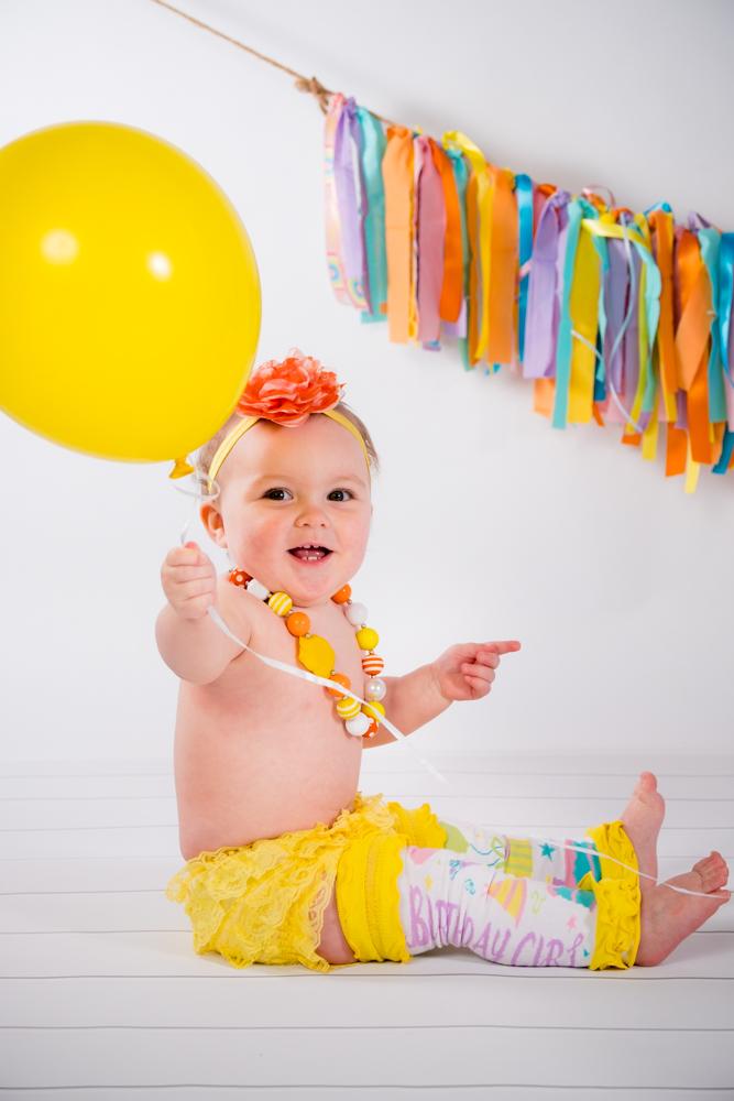 Birthday girl with a yellow balloon