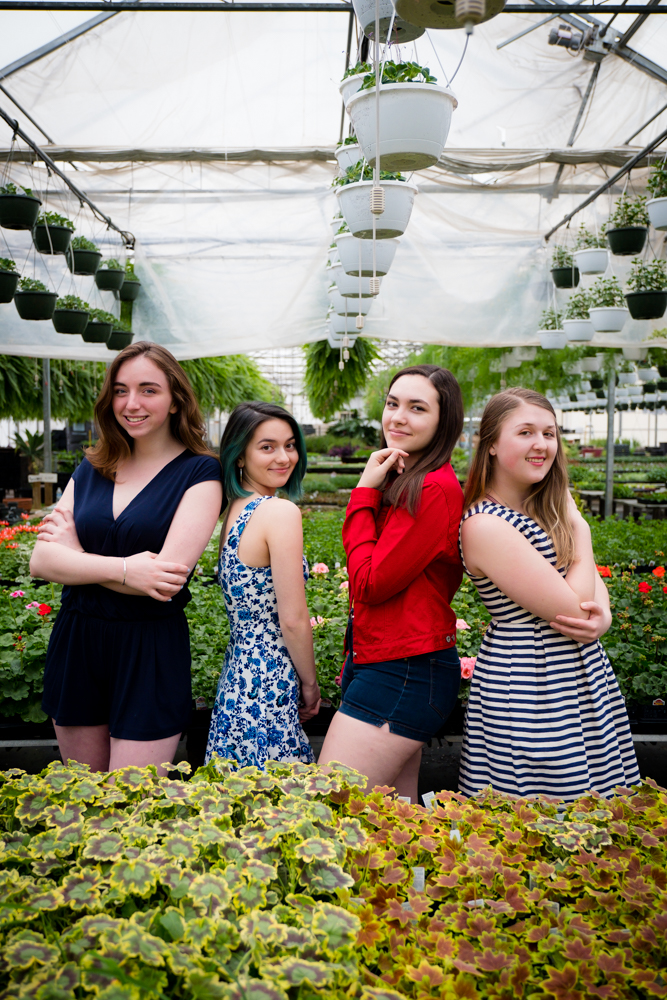 Senior models posing at a greenhouse