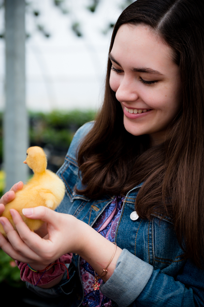 Senior girl with an adorable duckling