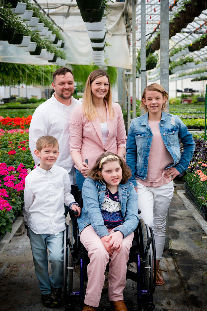Family of 5 in a greenhouse
