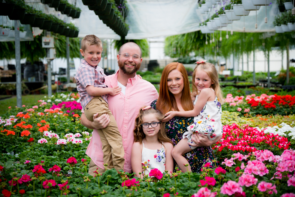 Family of five surrounded by flowers
