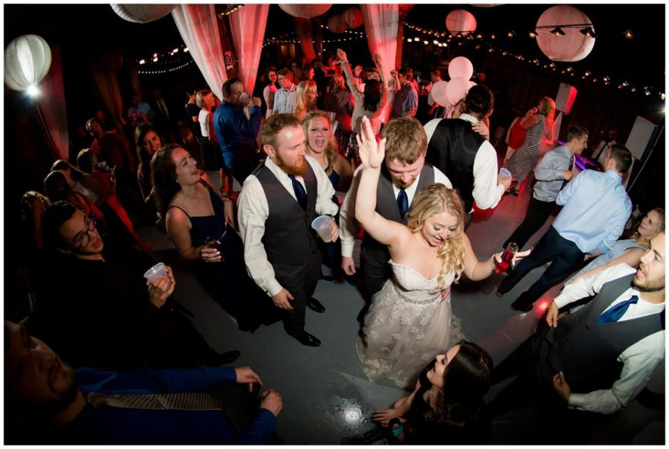 Bride and groom in the center of the dance floor dancing the night away!