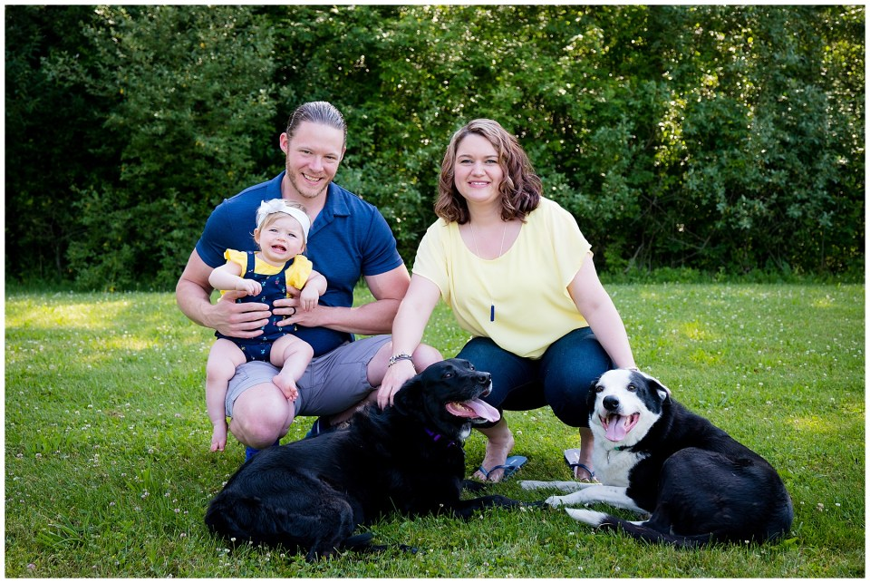 Family photo with two happy dogs.