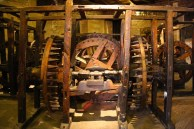 The gears would ultimately press glowing hot silver into uniform sheets from which indigenous workers would mint silver coins.