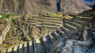 The mountainsides of Ollantaytambo, Peru are covered by an extensive set of agricultural terraces which start at the bottom of the valleys and climb up the surrounding hills. The terraces permitted farming on otherwise unusable terrain; they also allowed the Incas to take advantage of the different ecological zones created by variations in altitude. Land inside the terrace is protected from the wind by lateral walls which also absorb solar radiation during the day and release it during the night; this creates a microclimate zone 2 to 3°C warmer than the ground above it. These conditions allowed the Incas to grow species of plants native to lower altitudes that otherwise could not have flourished at this site.