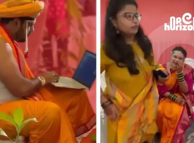 work-from-wedding-video-of-groom-sitting-with-laptop
