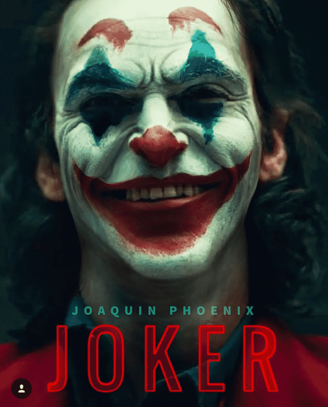 man being depicted as joker with face paint of clown