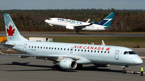 An Air Canada and WestJet plane.