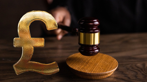 Gavel with pound currency symbol.