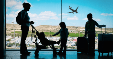 Family waiting at the airport, unvaccinated children
