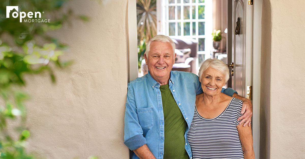 Senior couple in doorway