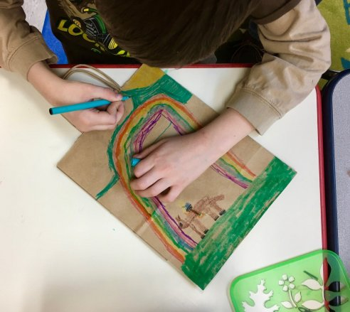 Kids get creative when they decorate a paper bag, to be used later for the homeless ministry.