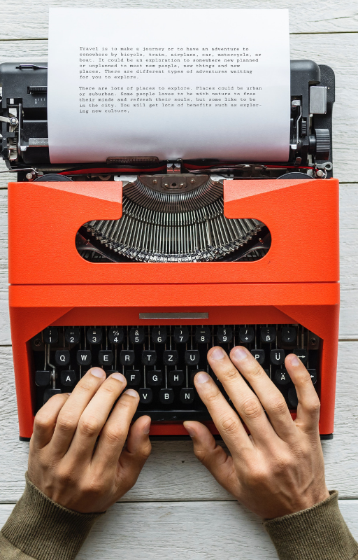photo of typewriter with a paper fixed in it