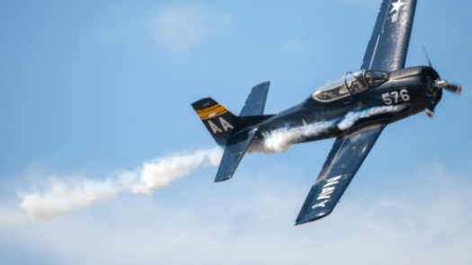 black biplane doing aerobatics