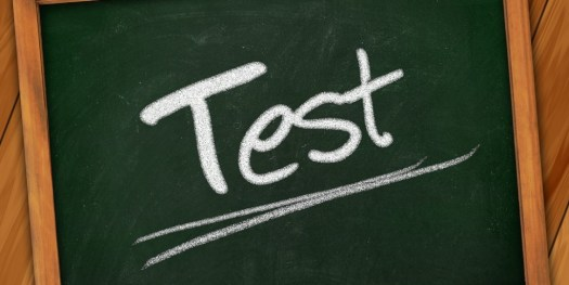 Image of green board where test is written with chalk