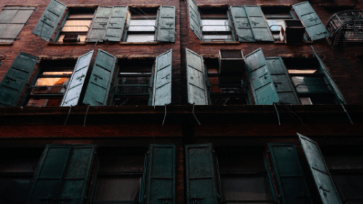 photography of windows outside the building where some of them are closed and some of them are open