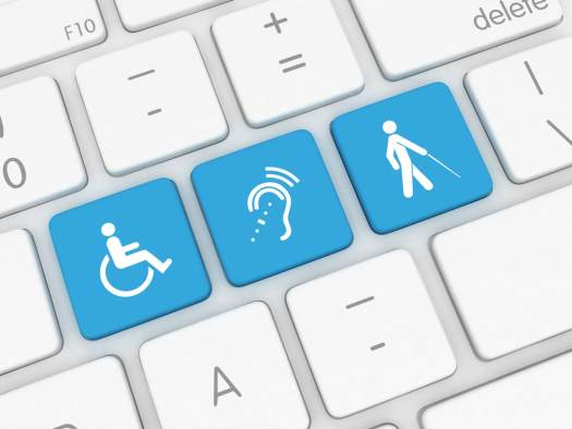 three blue keys with a man in wheelchair, ear, and a man walking with a stick on a white keyboard