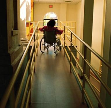 A hospital ramp with a woman is sitting in a wheelchair