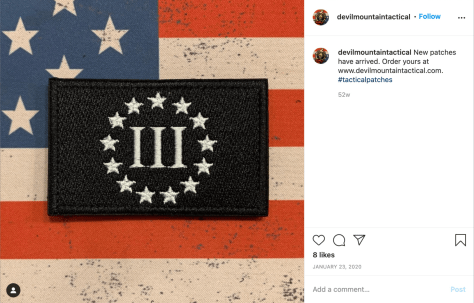 A screenshot from Instagram depicting a close-up image of a Three Percenter militia patch.
