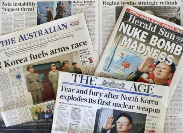 The front pages of a number of newspapers carry large headlines denouncing the Oct. 9 explosion of a nuclear bomb by North Korea, Oct. 10, 2006. Photo: Getty Images/WILLIAM WEST/AFP