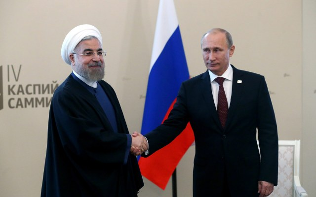 Russian President Vladimir Putin (R) meets with Iran President Hassan Rouhani during the Caspian Sea Summit on September 29, 2014 in Astrakhan, Russia.