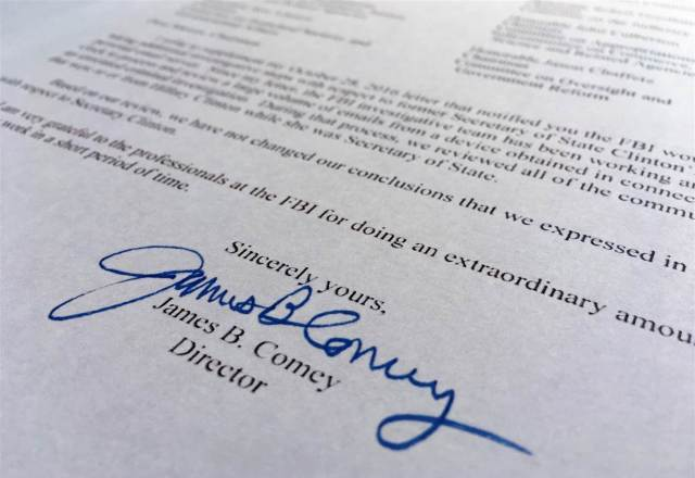 Part of a Nov. 6, 2016, letter from FBI director James Comey to Congress is photographed in Washington, Sunday, Nov. 6, 2016. Jon Elswick / AP