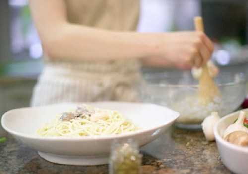 Young Woman Preparing Noodles