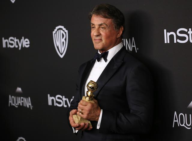 Sylvester Stallone, winner of the award for best performance by an actor in a supporting role in any motion picture for Creed, arrives at the InStyle and Warner Bros. Golden Globes afterparty at the Beverly Hilton Hotel on Sunday, Jan. 10, 2016, in Beverly Hills, Calif. (Photo by Matt Sayles/Invision/ANSA/AP)