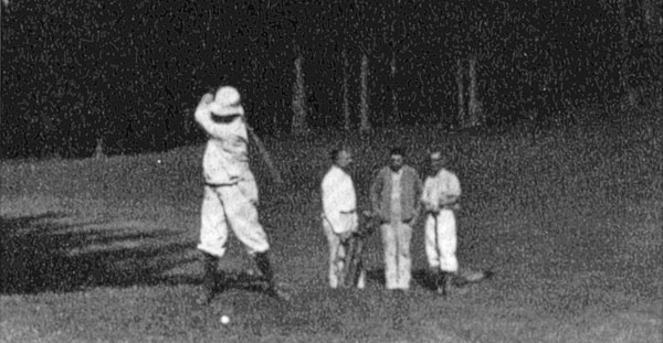 "Four men playing golf on ""Blowmedown Links."""