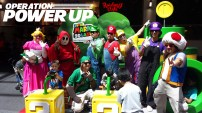 Mario cosplayers found at Super Mario 3D Land set, with Link.