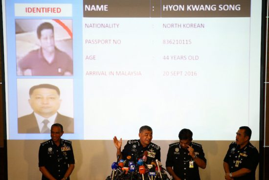 Malaysia's Royal Police Chief Khalid Abu Bakar (C) speaks next to a screen showing North Korean Hyon Kwang Song during a news conference regarding the apparent assassination of Kim Jong Nam, the half-brother of the North Korean leader, at the Malaysian police headquarters in Kuala Lumpur, Malaysia, February 22, 2017. REUTERS/Athit Perawongmetha     TPX IMAGES OF THE DAY