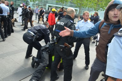 picture of the violent police arrests at Luxemburg during the march for freedom