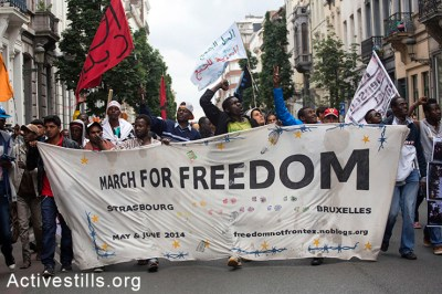 Activists carry a banner during the final day of the March for Freedom
