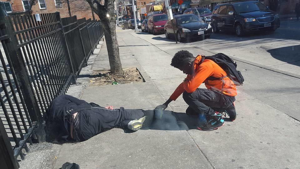 This young man stopped dead in his tracks to pray for a homeless man.