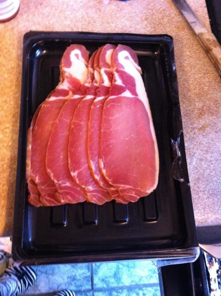 A stack of bacon that looks like a stack of penguins.