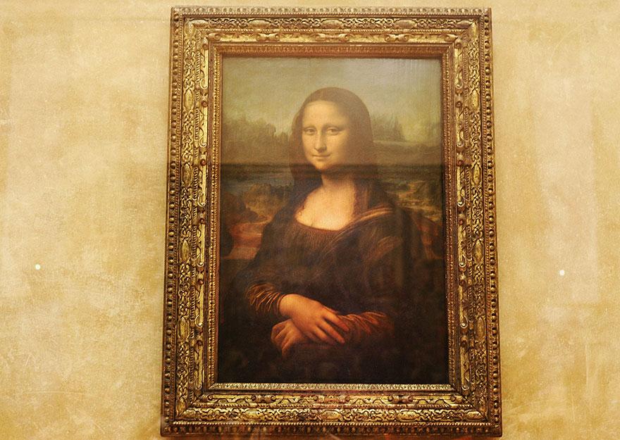 Admiring Mona Lisa In Louvre Museum, Paris, France