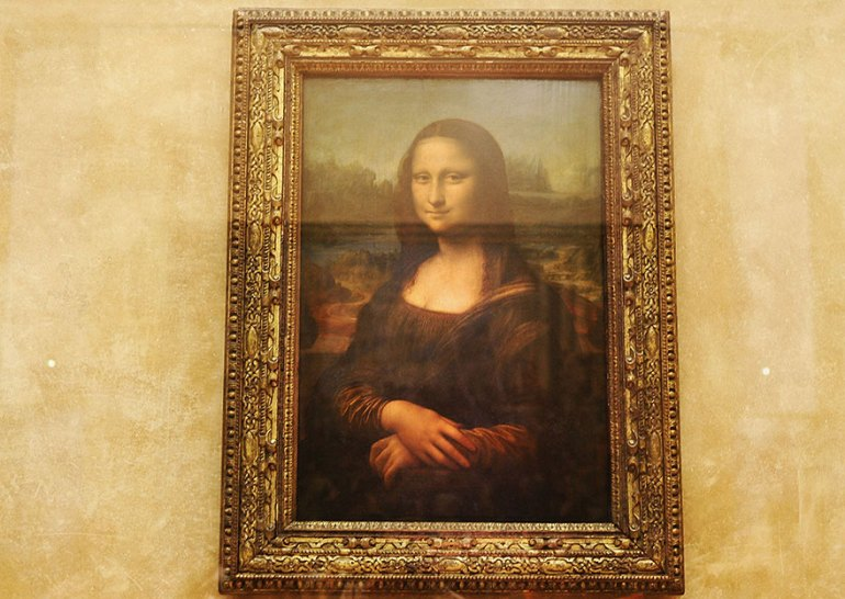 Admiring Mona Lisa In Louvre Museum, Paris, France