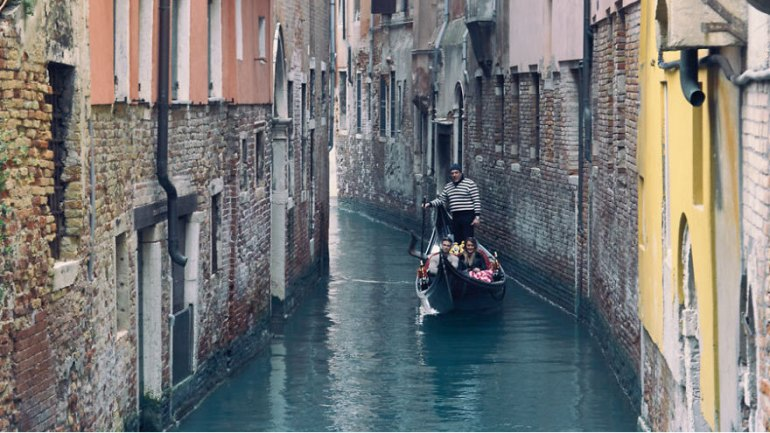 Taking A Peaceful Gondola Ride In Venice, Italy