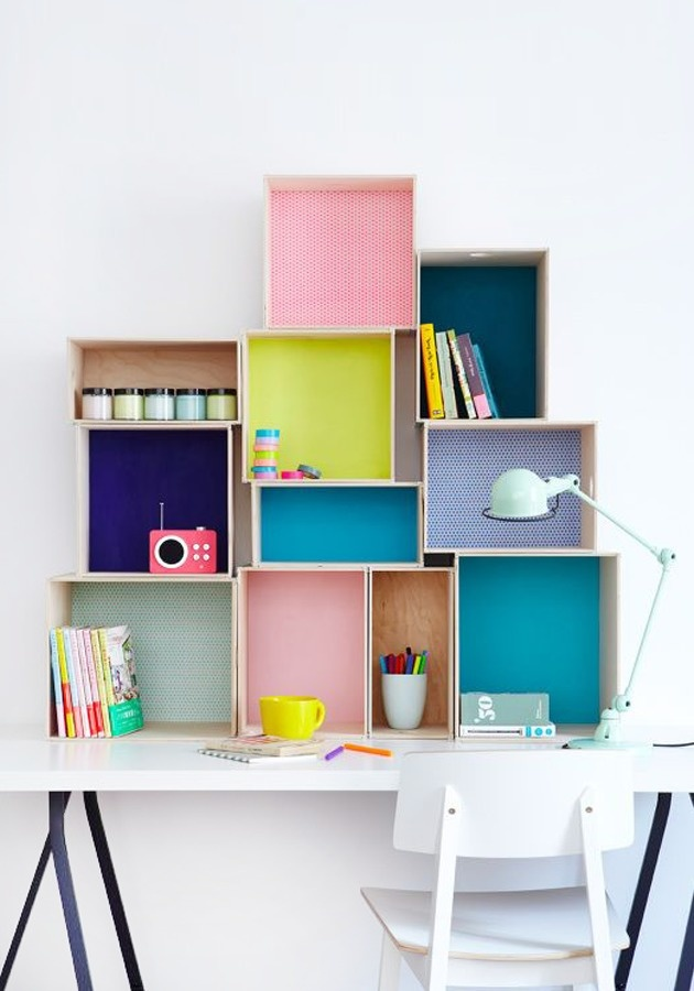 Put colored paper in the back of wooden crates to create chic storage.