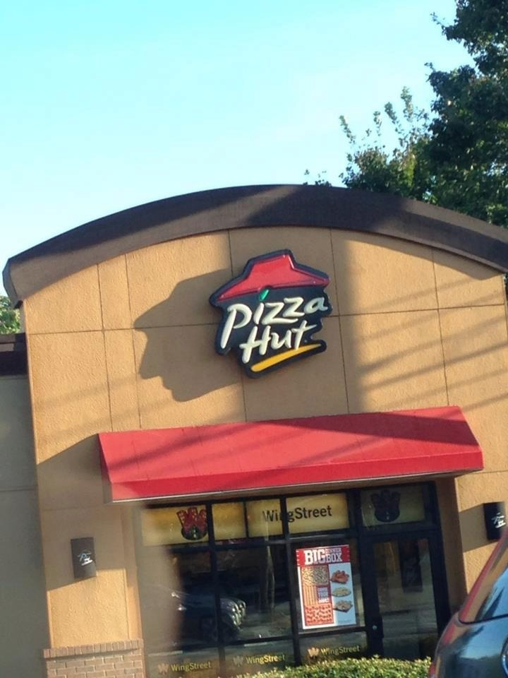 Pizza Hut, or just a dude with a hat?