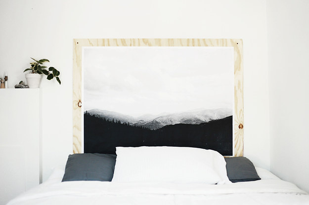 Make a headboard out of wood and enlarge and print out a photo you like to attach to it.
