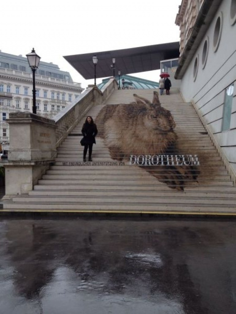A giant bunny on some stairs in Albertina, Vienna.