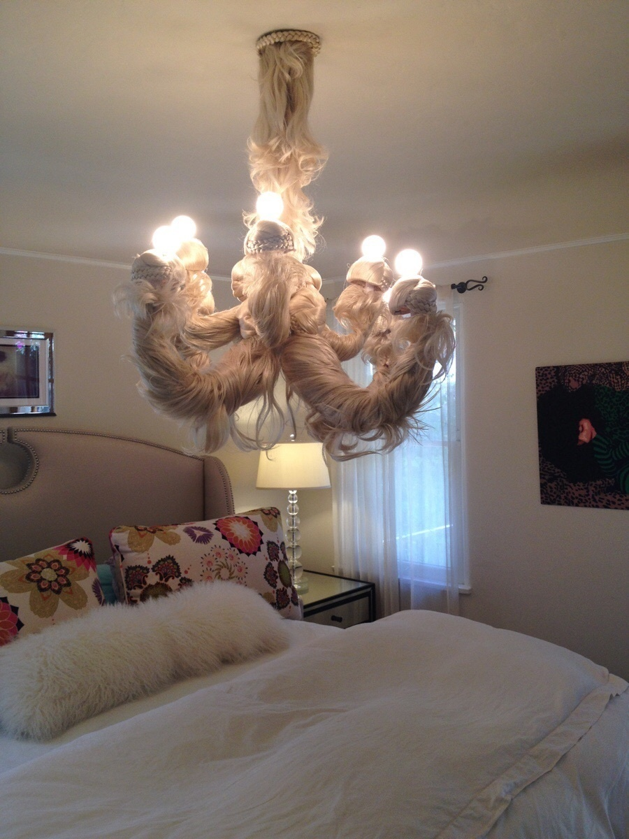 A chandelier made out of doll hair.