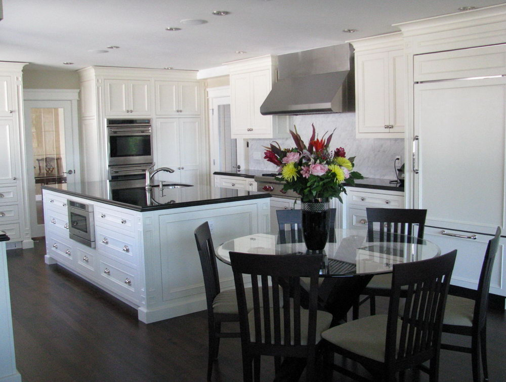 Kitchen With White Cabinets And Dark Countertops