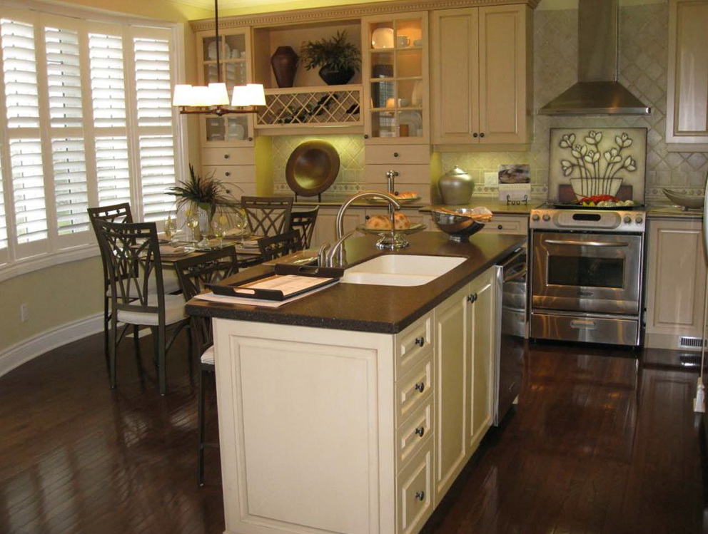 Kitchen With White Cabinets And Dark Floors